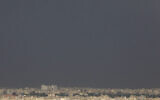 Rooftops are seen under an overcast sky of Tehran, Iran, May 8, 2021. (Vahid Salemi/AP)