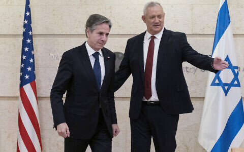 US Secretary of State Antony Blinken (L) and Defense Minister Benny Gantz move to take their seats before their meeting at the Foreign Ministry on May 25, 2021, in Jerusalem, Israel. (AP Photo/Alex Brandon, Pool)