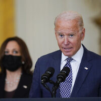 US President Joe Biden speaks about the evacuation of American citizens, their families, SIV applicants and vulnerable Afghans in the East Room of the White House on Aug. 20, 2021, in Washington. US Vice President Kamala Harris listens at left. (AP Photo/Manuel Balce Ceneta)