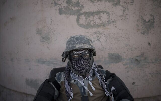 A Taliban fighter guards the entrance of the Pul-e-Charkhi prison in Kabul, Afghanistan, Monday, Sept. 13, 2021 (AP Photo/Felipe Dana)