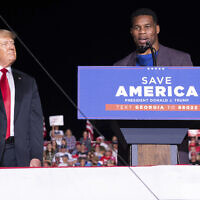 Former president Donald Trump listens as Georgia Senate candidate Herschel Walker speaks during his Save America rally in Perry, Ga., on Saturday, Sept. 25, 2021. (AP Photo/Ben Gray)