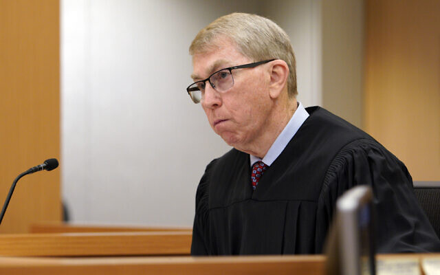 FILE – In this Tuesday, April 30, 2019, file photo, Judge Joseph P. Brannigan looks on during the arraignment hearing for John T. Earnest in San Diego. (Nelvin C. Cepeda/The San Diego Union-Tribune via AP, Pool, File)