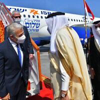 Israel's Foreign Minister Yair Lapid is met by his Bahraini counterpart, Abdullatif bin Rashid Alzayani, center right, for the first high-level visit in Manama, Bahrain, Thursday, Sept. 30, 2021 (Shlomi Amshalem/GPO via AP)