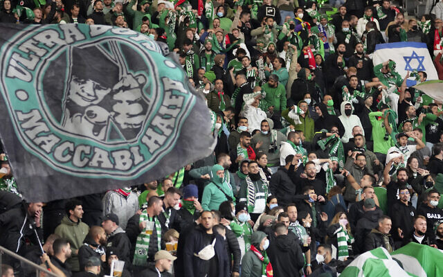 Supporters of Maccabi Haifa attend a group E Europa Conference League soccer match between FC Union Berlin and Maccabi Haifa FC in Berlin, Germany, September 30, 2021. (Michael Sohn/AP)