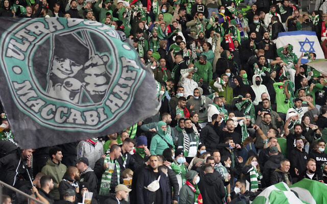 Supporters of Haifa attend a group E Europa Conference League soccer match between 1. FC Union Berlin and Maccabi Haifa FC in Berlin, Germany, Sept. 30, 2021. (AP Photo/Michael Sohn)