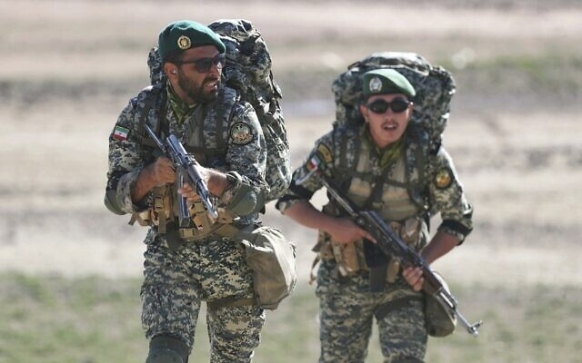 This undated picture released by the official website of the Iranian Army on Friday, Oct. 1, 2021, shows ground forces troops attending a maneuver near Iranian border with Azerbaijan (Iranian Army via AP)