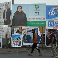 Campaign posters for upcoming parliamentary elections are displayed in Baghdad, Iraq, October 3, 2021. (Hadi Mizban/AP)