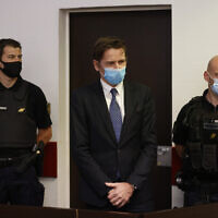 Rémy Daillet-Wiedemann, a former French politician whose popularity grew when he spread QAnon-style conspiracy theories, appears in court in Nancy, France on June 16, 2021, on charges he orchestrated the kidnapping of an 8-year-old girl whose mother had lost custody of her. (AP Photo/Jean-Francois Badias)