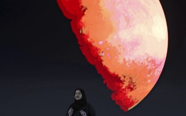 Sarah Al Amiri, Emirati Minister of State for Advanced Sciences and Deputy Project Manager of the Emirates Mars Mission speaks ahead of a live broadcast of the Hope Probe as it attempts to enter Mars orbit as a part of Emirates Mars mission, in Dubai, United Arab Emirates, February 9, 2021. (AP Photo/Kamran Jebreili, File)