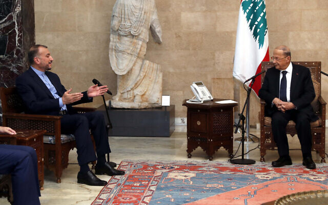 Lebanese President Michel Aoun, right, meets with Iranian Foreign Minister Hossein Amirabdollahian, at the presidential palace, in Baabda, east of Beirut, Lebanon, October 7, 2021. (Dalati Nohra via AP)
