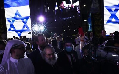 Jewish and Arab attendees celebrate the opening of the Israeli pavilion at Expo 2020 in Dubai, United Arab Emirates, on Thursday, October 7, 2021. (AP Photo/Jon Gambrell)