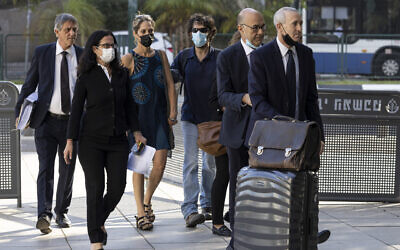 Aya Biran, third from left, a paternal aunt of Eitan Biran, who survived a cable car crash in Italy that killed his immediate family, arrives to court in Tel Aviv Friday, Oct. 8, 2021 ( AP Photo/Tsafrir Abayov)