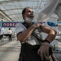 In this July 12, 2021 file photo, a medical worker administers a shot of Russia's Sputnik V coronavirus vaccine at a vaccination center in Gostinny Dvor, a huge exhibition place in Moscow, Russia. (AP/Pavel Golovkin)