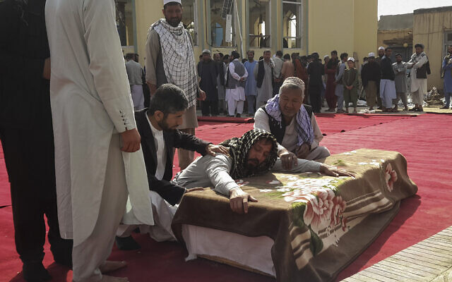 Relatives and residents attend a funeral ceremony for victims of a suicide attack at the Gozar-e-Sayed Abad Mosque in Kunduz, northern Afghanistan, October 9, 2021. (AP Photo/Abdullah Sahil)