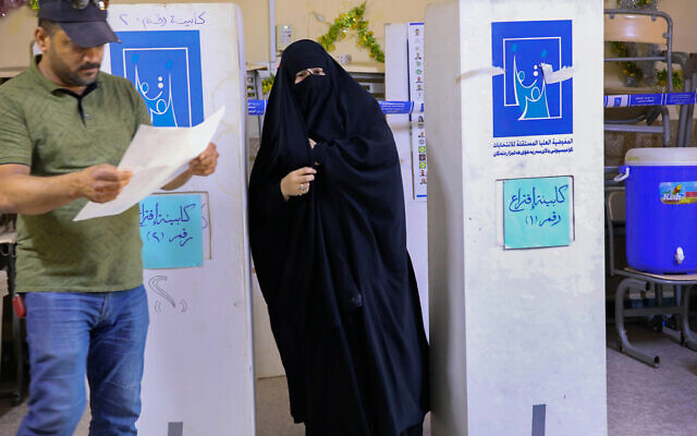 People cast their votes during the parliamentary elections in Basra, Iraq, Sunday, Oct. 10, 2021. (AP Photo/Nabil al-Jurani)