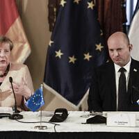 German Chancellor Angela Merkel speaks as she attends a cabinet meeting with Israeli Prime Minister Naftali Bennett in Jerusalem, Sunday, Oct. 10, 2021. (Menahem Kahana/Pool Photo via AP)