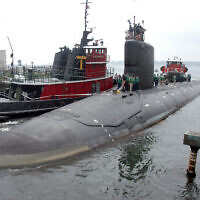 The USS Virginia returns to the Electric Boat Shipyard in Groton, Connecticut, after its first sea trials, July 30, 2004. (AP Photo/ Jack Sauer, File)