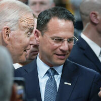 Pennsylvania Attorney General Josh Shapiro, center, and US President Joe Biden talk with people at the Lehigh Valley operations facility for Mack Trucks in Macungie, Pennsylvania, July 28, 2021. (AP Photo/Susan Walsh, File)