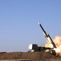 This photo released Tuesday, Oct. 12, 2021, by the Iranian Army, shows a missile being fired during a military drill at an undisclosed location in Iran. (Iranian Army via AP)