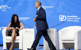 Russian President Vladimir Putin walks past CNBC's anchor Hadley Gamble during the plenary session of the Russian Energy Week in Moscow, Russia, October 13, 2021. (Sergei Ilnitsky/Pool Photo via AP)