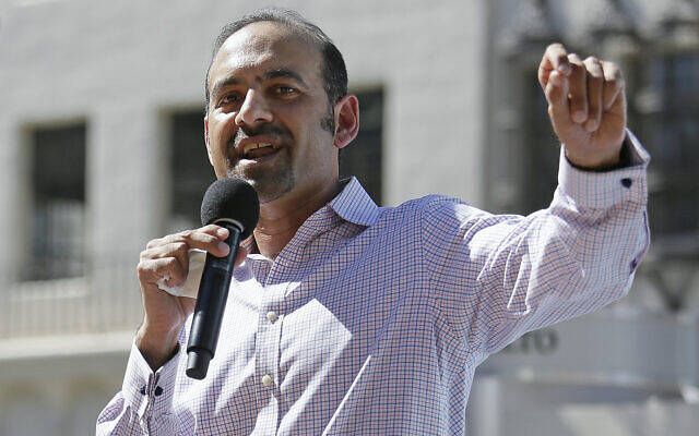 Dilawar Syed, president of the software company Freshdesk, speaks during a Tech Stands Up rally outside City Hall in Palo Alto, California, March 14, 2017. (Eric Risberg/AP)