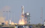 Blue Origin's New Shepard rocket launches carrying passengers William Shatner, Chris Boshuizen, Audrey Powers and Glen de Vries from its spaceport near Van Horn, Texas, Wednesday, Oct. 13, 2021. (AP Photo/LM Otero)