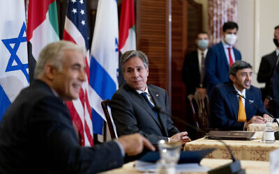 US Secretary of State Antony Blinken accompanied by Foreign Minister Yair Lapid, left, and United Arab Emirates Foreign Minister Sheikh Abdullah bin Zayed al-Nahyanin, right, appear at a joint news conference at the State Department in Washington, October 13, 2021. (AP Photo/Andrew Harnik, Pool)