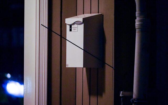 An arrow left in a wall after an attack in Kongsberg, Norway, October 13, 2021. (Hakon Mosvold Larsen/NTB Scanpix via AP)