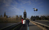 The scaffolded Elizabeth Tower, known as Big Ben, and the Houses of Parliament are seen from Westminster Bridge, in London, Thursday, Oct. 14, 2021. (AP Photo/Matt Dunham)