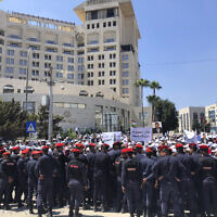 In this Sept. 5, 2019 file photo, security forces block a road as teachers protest in Amman, Jordan. (AP Photo/Omar Akour, File)
