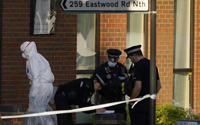 Police officers talk at the scene outside the Belfairs Methodist Church in Eastwood Road North, where British Conservative lawmaker David Amess has died after being stabbed at a constituency surgery, in Leigh-on-Sea, Essex, England, Friday, Oct. 15, 2021. (AP/Alberto Pezzali)