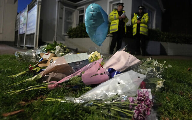 Floral tributes are placed on one of the roads leading to the Belfairs Methodist Church in Eastwood Road North, where British Conservative lawmaker David Amess has died after being stabbed at a constituency surgery, in Leigh-on-Sea, Essex, England, Friday, Oct. 15, 2021. (AP Photo/Kirsty Wigglesworth)