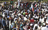 Sudanese protesters take part in a rally demanding the dissolution of the transitional government, outside the presidential palace in Khartoum, Sudan, Saturday, Oct. 16, 2021. (AP Photo/Marwan Ali)