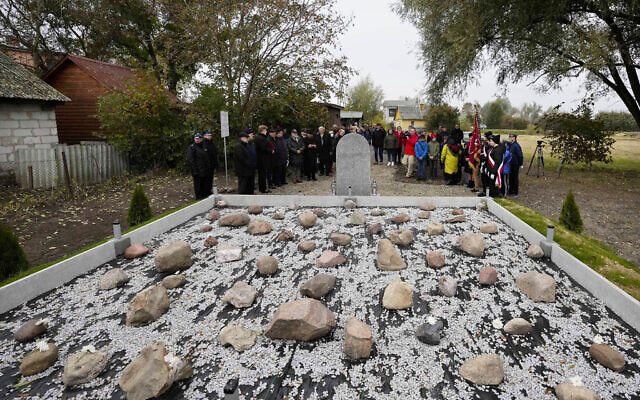 Jewish and Christian clergy stand together for prayers for the souls of some 60 Jews murdered by the occupying Nazi German forces during a ceremony marking a memorial to the victims in Wojslawice, Poland, October 14, 2021. (AP Photo/Czarek Sokolowski)