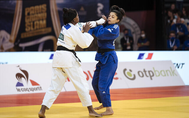 Gefen Primo, of Israel, right, competes against Astride Gneto of France, during the women's -52kg final match at the Grand Slam Paris 2021 Judo tournament, in Paris, France, October 16, 2021. (AP Photo/Lewis Joly)
