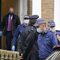 Police search a house believed to be in relation to the slaying of member of Parliament David Amess, in London, October 17, 2021. (Dominic Lipinski/PA via AP)