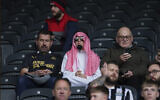 Newcastle fans wait for the start of an English Premier League soccer match between Newcastle and Tottenham Hotspur at St. James' Park in Newcastle, England, Sunday Oct. 17, 2021. (AP Photo/Jon Super)