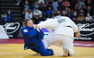 Raz Hershko of Israel, in blue, competes against Lea Fontaine of France during the women's +78kg final match at the Grand Slam Paris 2021 Judo tournament, in Paris, France, Sunday, Oct. 17, 2021. (AP Photo/Lewis Joly)