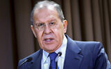 In this handout photo released by the Russian Foreign Ministry Press Service, Russian Foreign Minister Sergey Lavrov speaks on the side of the meeting dedicated to the 25th anniversary of the House of Russian Diaspora named after Alexander Solzhenitsyn in Moscow, Russia, October 18, 2021. (Russian Foreign Ministry Press Service via AP)