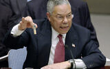 Then-US secretary of state Colin Powell holds up a vial he said could contain anthrax as he presents evidence of Iraq's alleged weapons programs to the United Nations Security Council, on February 5, 2003. (AP Photo/Elise Amendola, File)