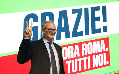 Center-left mayoral candidate Roberto Gualtieri flashes a v-sign at his party's headquarters in Rome, October 18, 2021. (Gregorio Borgia/AP)