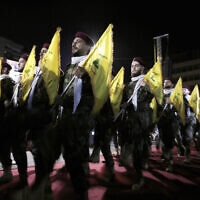 In this May 31, 2019 file photo, Hezbollah fighters march at a rally to mark Jerusalem day or Al-Quds day, in the southern Beirut suburb of Dahiyeh, Lebanon. On Monday, Oct. 18, 2021, Hezbollah leader Sheik Hassan Nasrallah revealed that his terror group has 100,000 trained fighters. (AP Photo/Hassan Ammar, File)