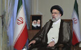 In this photo released by the office of the Iranian Presidency, President Ebrahim Raisi speaks during a live interview in Tehran, Iran, broadcast on state-run TV on Monday, Oct. 18, 2021. (Iranian Presidency Office via AP)