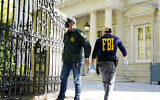 FBI agents stand in front of a home of Russian oligarch Oleg Deripaska, October 19, 2021 in Washington. (AP Photo/Manuel Balce Ceneta)