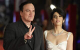 Director Quentin Tarantino, left, and wife Daniella Pick pose on the red carpet for the Lifetime Achievement Award ceremony at the 16th edition of the Rome Film Fest in Rome, October 19, 2021. (AP Photo/Gregorio Borgia)
