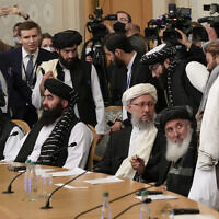 Taliban official Abdul Salam Hanafi, center, and other members of the political delegation from the Afghan Taliban's movement arrive to attend the talks involving Afghan representatives in Moscow, Russia, October 20, 2021. (AP Photo/Alexander Zemlianichenko, Pool)