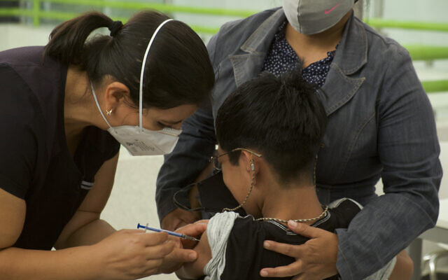 Illustrative -- A healthcare worker injects a boy with a dose of the Pfizer COVID-19 vaccine, during a vaccination drive for children between the ages of 12-17, in Tuxtla Gutierrez, Mexico, Oct. 20, 2021. (AP Photo/Isabel Mateos)