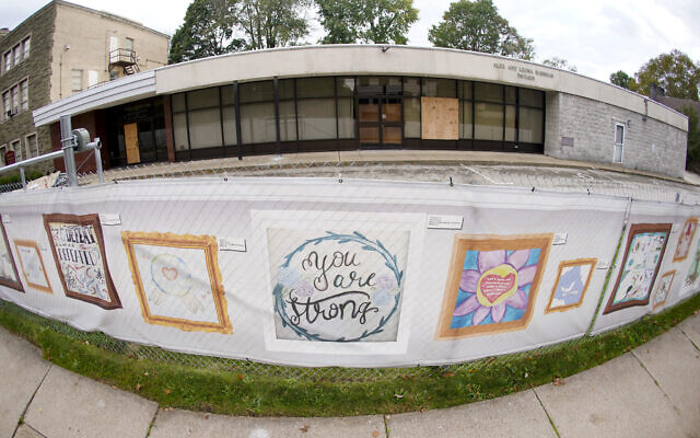 This photo from Oct. 16, 2021, shows the dormant landmark Tree of Life synagogue with the fencing showing artwork submitted by Pittsburgh area school students in Pittsburgh's Squirrel Hill neighborhood. (AP Photo/Keith Srakocic)