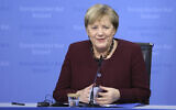 German Chancellor Angela Merkel speaks during a media conference at an EU summit in Brussels, Oct. 22, 2021 (Aris Oikonomou, Pool Photo via AP)