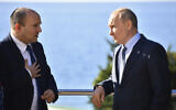 Russian President Vladimir Putin (right) and Prime Minister Naftali Bennett speak during their meeting in Sochi, Russia, on October 22, 2021. (Evgeny Biyatov, Sputnik, Kremlin Pool Photo via AP)